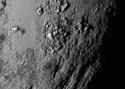 """One of the first images near Pluto's equator reveals a range of """"youthful"""" mountains ranging about 100 million years old and about 11,000 feet high."""