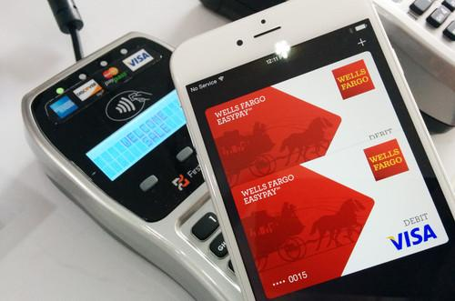 An iPhone 6 being used to make an NFC payment via Apple Pay