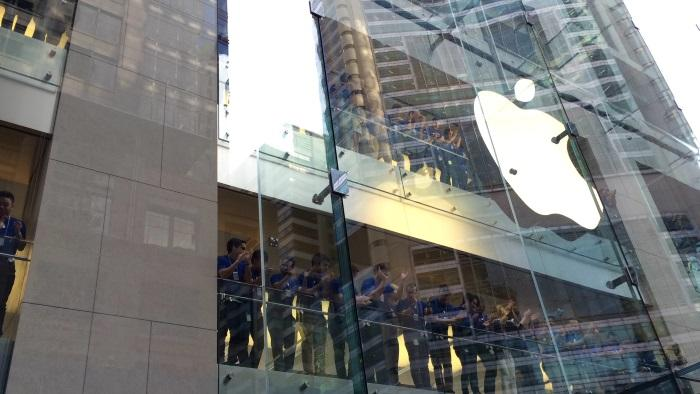 Apple staff line the balconies...