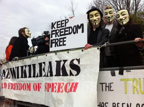 Concern is increasing that Anonymous may target critical infrastructure, and while analysts say it is possible, it is probably not likely. Pictured are supporters of Supporters for WikiLeaks founder Julian Assange outside a London court in February 2011.
