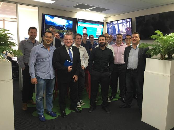 Sam Bashiry (front left), Bruce Billson (second from front left), with new staff
