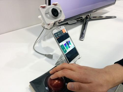 Dowell, shown at the 2015 Computer-Human Interaction Conference in Seoul, is designed to allow people with upper-limb paralysis to use smartphones. It can be used with the head-tracking sensor and trackball mouse seen here as well as other assistive devices.