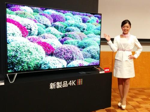 A model shows off Sharp's Aquos 4K Next, which can upscale to 8K resolution, at a press conference May 21, 2015 in Tokyo.
