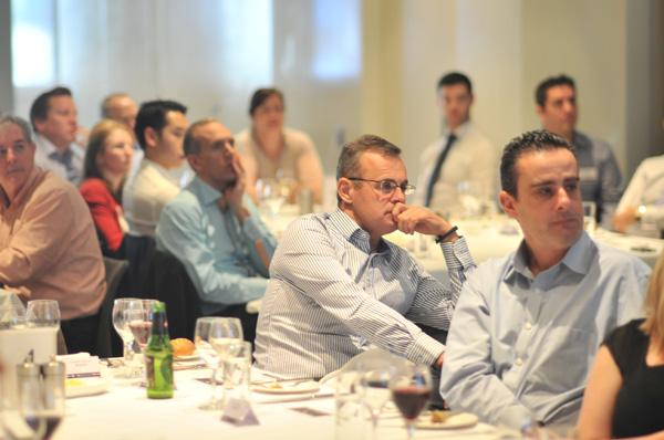 Attendees listen to Channel Dynamic's Moheb Moses speak about transitioning to the Cloud