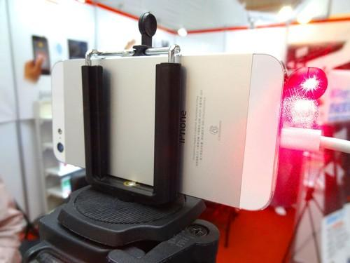 At the Computex 2015 trade expo in Taipei June 4, Conary Enterprise shows off the iPin Laser Ruler, an iPhone laser pointer dongle that works with a camera app to measure distances. It's slated to go on sale later this year for about US$56.