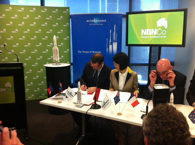 Minister for Broadband, Communications, and the Digital Economy, Senator Stephen Conroy (left), signing the Arianespace contract with the NBN