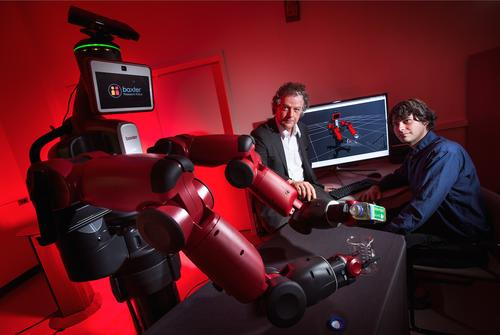 University of Maryland computer scientist Yiannis Aloimonos (center) is helping robots such as Rethink Robotics' Baxter learn new skills by watching YouTube videos.