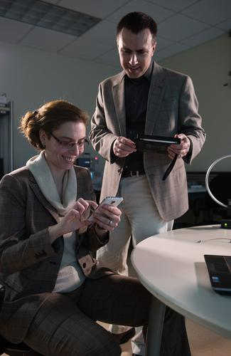 Georgia Tech researchers Alenka Zajic and Milos Prvulovic use an AM/FM radio to pick up side-channel signals from a cell phone, which could be used to learn what computations are being done by the device.