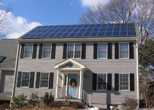 A grid-connected photovoltaic power system on the roof of a house near Boston.