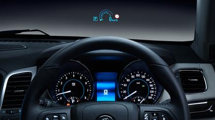 A head-up display unit projects information like speed directly onto the drivers windscreen.