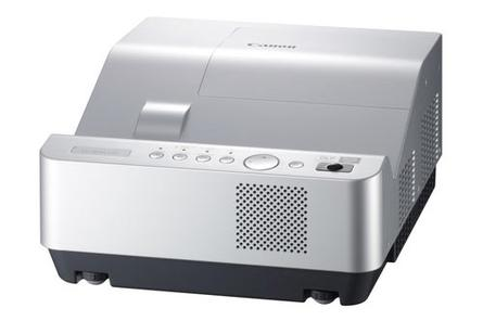 "Canon announced its first ""ultra short-throw"" projector, which can produce an 80-inch image from an inch away."