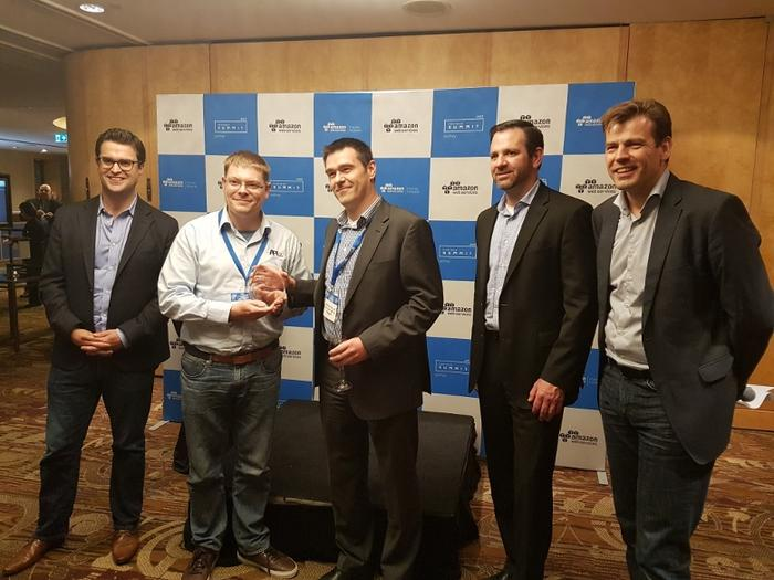 API Talent receiving the rising star award with AWS managing director A/NZ, Paul Migliorini, vice president of channels and alliances, Terry Wise, and Stefan Jansen