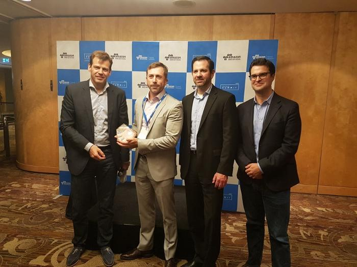 Technology One receiving the technology partner of the year award with Stefan Jansen, Terry Wise and Paul Migliorini (AWS)